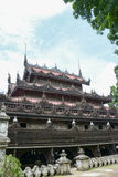 Landmark bagaya kyauang temple and Old wooden temple at Mandalay city of Myanmar Royalty Free Stock Photography