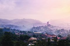 Landmark of Bandung From Dago Hill/Mountain at Sunrise on Misty and Fog Morning. Concept of Utopia Future Eco-friendly City stock image