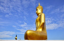 Landmark Buddha statue rising into sky Stock Photos