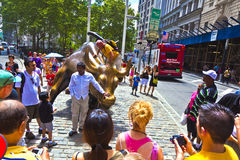 Landmark Charging Bull in Lower. NEW YORK CITY - JULY 09: The landmark Charging Bull in Lower Manhattan represents the strength and power of the American People Royalty Free Stock Image