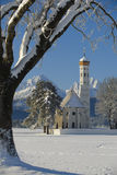 Landmark church St. Coloman in bavaria. Famous church St. Coloman in bavaria, germany with alps mountains at sunny winter day Stock Images