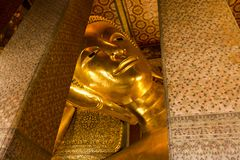 Landmark, Close Up Beautiful Big Buddha Reclining,Golden statue Temple Wat Pho in Asia Bankok Thailand Stock Image