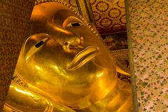 Landmark, Close Up Beautiful Big Buddha Reclining,Golden statue Temple Wat Pho in Asia Bankok Thailand Royalty Free Stock Images