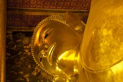 Landmark, Close Up Beautiful Big Buddha Reclining,Golden statue Temple Wat Pho in Asia Bankok Thailand Stock Photo
