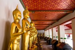 Landmark, Close Up Beautiful Black Buddha statue,standing Buddha statue,Golden statue Temple Wat Pho in Asia Bankok Thailand. 2017 Royalty Free Stock Photos