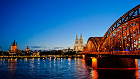 Landmark of Cologne. This is a Picture of the landmark of Cologne from the view of Deutz. The Bridge is the Hohenzollernbrücke. The Photo is taken at night Stock Photos