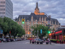 Landmark Delta Bessborough Hotel. SASKATOON, CANADA - JULY 2: Landmark Delta Bessborough Hotel on July 2, 2016 in Saskatoon, Saskatchewan, Canada. Setting sun Royalty Free Stock Photography