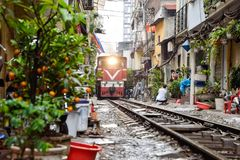 Landmark of Hanoi : Close up of old train running on railway in the afternoon at Hanoi, Vietnam, Transport of Hanoi stock photo