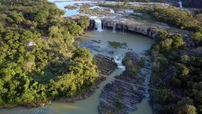 Landmark Huge Waterfall on Round Cliffs Upper View. Fantastic upper view beautiful popular landmark waterfall on round cliffs among wild jungle under evening stock footage