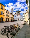 Italy - art and religion. Lucca medieval town - square with San stock images