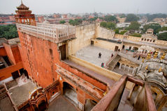Landmark of Jaipur - walls of Palace of Winds. JAIPUR, INDIA: High walls from red and pink sandstone of Hawa Mahal built in 1799 (Palace of Winds). Jaipur with Stock Photo
