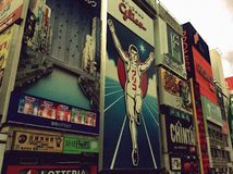 Landmark in Osaka. This big advertisement board is already been there for many years by the river. Now it became a popular landmark of Osaka Japan. Means keep Royalty Free Stock Image