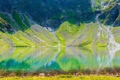 A landmark of Poland in the high Tatras - a picturesque lake Czarny Staw stock photos