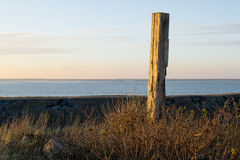 Landmark pole  on the seaside in the sunset. Stock Photography