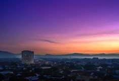 Purwokerto City At Sunrise. Aerial view. Landmark of Purwokerto city in Banyumas regency, Central Java at dawn before sunrise. Cityscape aerial view in misty stock image