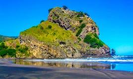 Lion rock, Piha Beach, Auckland, New Zealand royalty free stock photography