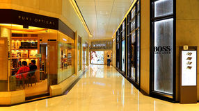 The landmark shopping mall interior, hong kong. Luxurious retail stores of fashion accessories within the landmark shopping mall, hong kong Stock Image