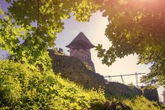 Landmark and travel destination. Castle tower and wall. Bastion on sunny summer day. Stone fortification on green hill on blue sky. Protection and defense stock photos