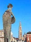 2 landmarks of Antwerpen , Belgium. 2 landmarks of city of Antwerpen, Belgium - statue close in the front and cathedral far in the back royalty free stock photos
