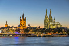 Landmarks of Cologne. Cologne, Germany - October 2, 2015:  Night view of Cologne Cathedral, Great St. Martin Church, and old town district of Cologne Stock Photo