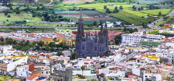 Landmarks of Gran Canaria - historic town Arucas with impressive cathedral. Canary islands. Old cathedral in Arucas village,Gran Canaria,Spain stock photography