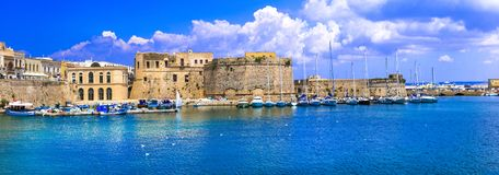 Landmarks of Puglia - old town of Gallipoli. south of Italy. Beautiful Gallipoli town,view with sea,old castle and houses,Puglia,Italy royalty free stock images