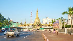 The landmarks of Yangon downtown - Sule Pagoda, Myanmar. YANGON, MYANMAR - FEBRUARY 14, 2018: The golden Sule Pagoda is one of the main landmarks of Downtown stock footage