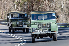 1949 Landrover Series 1 Utility driving on country road. Adelaide, Australia - September 25, 2016: Vintage 1949 Landrover Series 1 Utility driving on country stock photos