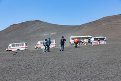 Landrovers ands tourists visiting Mount Etna of island Sicily, Italy stock image
