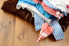 Landry pile of oktoberfest dirndle, shirt and leather pants. Royalty Free Stock Photo