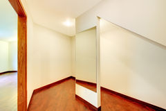 Landry room with maple custom build cabinets. Large room with build in cabinet and white Royalty Free Stock Image