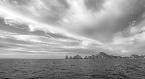 Lands End as seen from the Sea of Cortes at Cabo San Lucas in Baja California Mexico - black and whtie. Lands End as seen from the Sea of Cortes at Cabo San Royalty Free Stock Photo