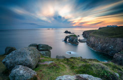Lands End in Cornwall. A long exposure of sunset at Lands End in Cornwall looking out towards the Long Ships lighthouse Royalty Free Stock Photos