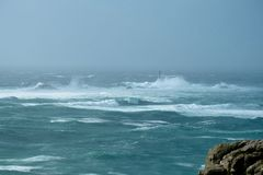 Lands End in Cornwall in a storm. The Longships lighthouse off Lands End in Cornwall, England, being battered by a severe storm. The lighthouse is 35 metres tall Royalty Free Stock Photography