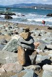Stack of stones at beach. Lands End, San Francisco, United States: ‎March ‎24, ‎2018 - A heart in the rock Royalty Free Stock Photography