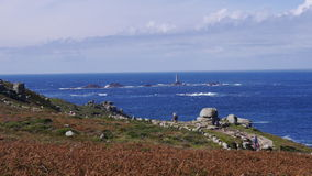 Lands End UK. Lands End in Far West Cornwall UK with The Longships Lighthouse offshore in the background Stock Images