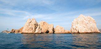 Lands End under cirrus clouds as seen from the Pacific Ocean at Cabo San Lucas in Baja California Mexico. Lands End as seen from the Pacific Ocean at Cabo San Royalty Free Stock Photo