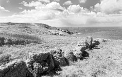 Lands End. A view from Land's End, the utmost eastern point of England in monochrome stock photos