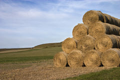 Straw bales hayrick. Landscape of straw bales and hills Royalty Free Stock Photography