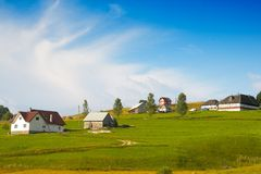 Landscape. Houses on the hill in the summer Royalty Free Stock Photos