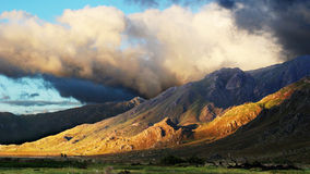 Landscape 4. Colour landscape of a clouds and mountains Royalty Free Stock Photos