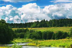 Landscape. Meadow, the blue sky and river Stock Photography