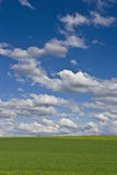 Landscape. The storm is over: cloudy blue sky on green field Royalty Free Stock Images