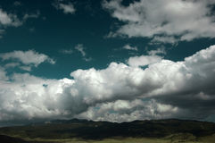 Landscape. Mountain view in springtime with blue sky and fluffy clouds stock photo