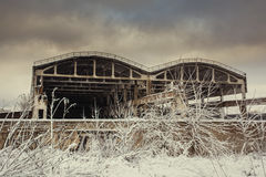Landscape with abandoned warehouse in winter Royalty Free Stock Photography