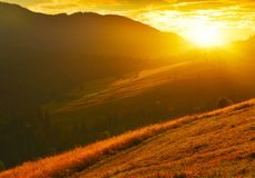 Landscape with abrupt slopes in highland at sunrise. Mountain landscape with rising sun in summer morning stock photography