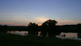 Landscape against the background of the rising sun. Time-lapse. 5K stock video footage