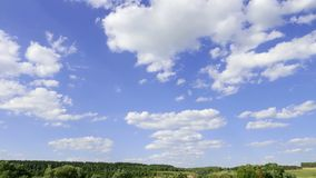 Landscape against a blue sky with white clouds. time interval, time-lapse. 5K stock video footage