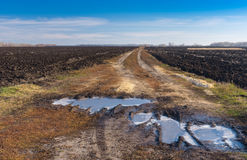 Landscape with agricultural fields and dirty road in central Ukraine. Autumnal landscape with agricultural fields and dirty road in central Ukraine Stock Images
