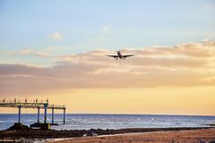 Landscape with airplain. Beautiful Lanzarote island landscape with airplain at sunset Stock Photography
